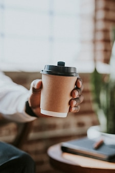 Man holding a takeaway coffee cup