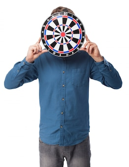Man holding a target on his face