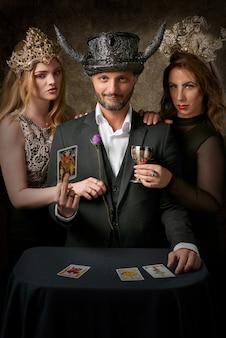 Man holding tarot card