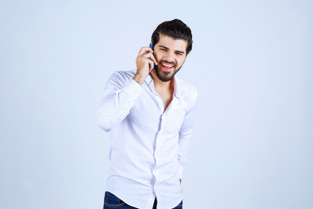 Man holding and texting or talking to the phone