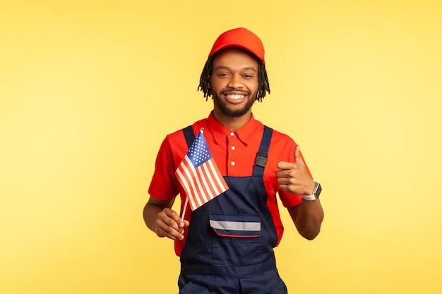 Man holding usa flag and showing thumbs up happy satisfied with life quality
