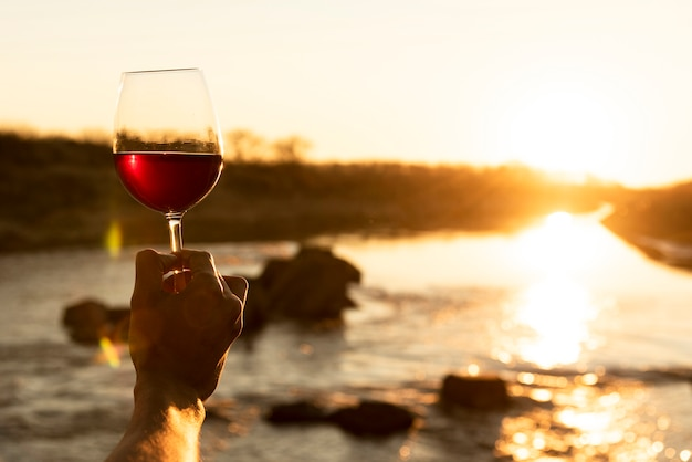 Man holding wine glass in the nature