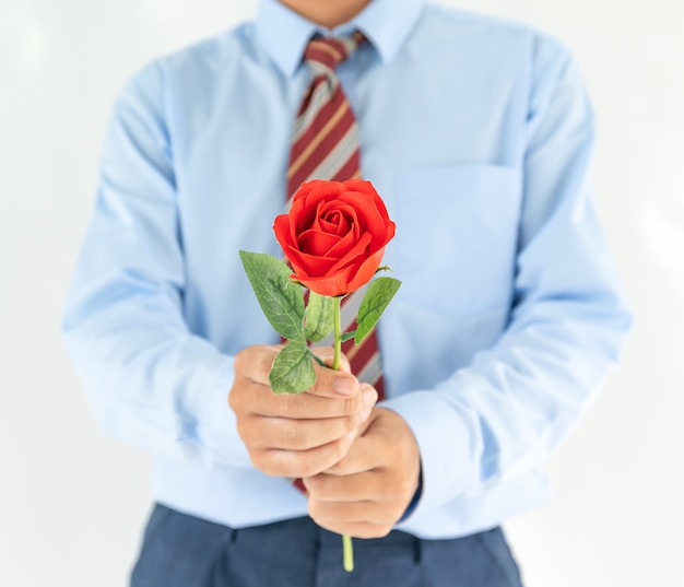 Man holding with red rose on white