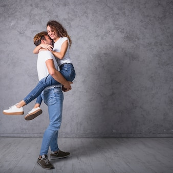 Man holding woman in arms