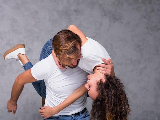 Man holding woman on shoulder