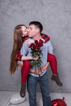 Man holding woman with roses on back