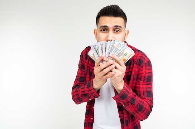 Man holds dollars in his hands on a white studio with copy space