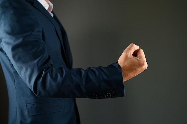 A man holds a fist in front