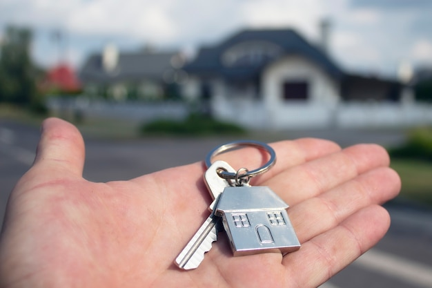 Man holds the keys to the house in his hands