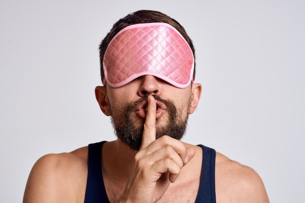A man in home clothes and a sleep mask