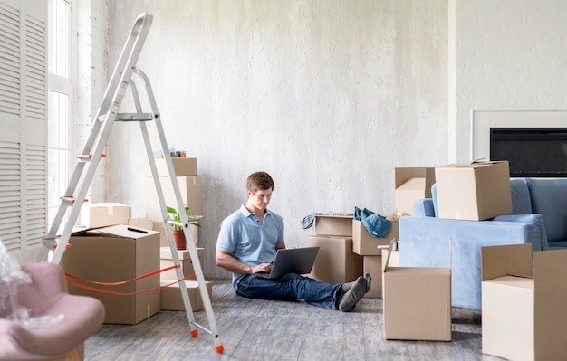 Man at home with boxes and ladder getting ready to move out