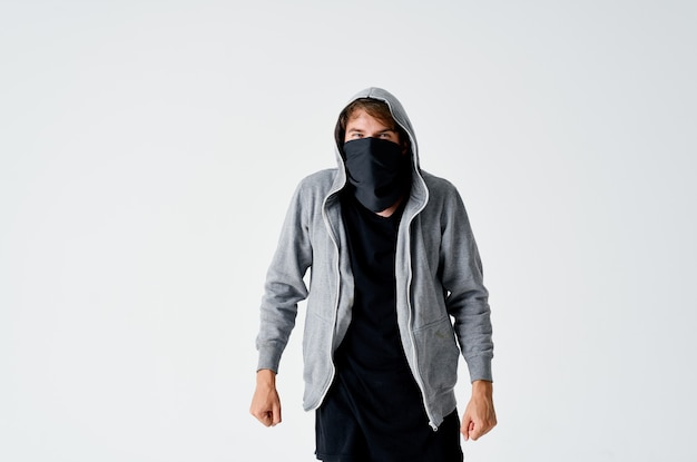 A man in a hood in a mask burglary theft anonymity crime