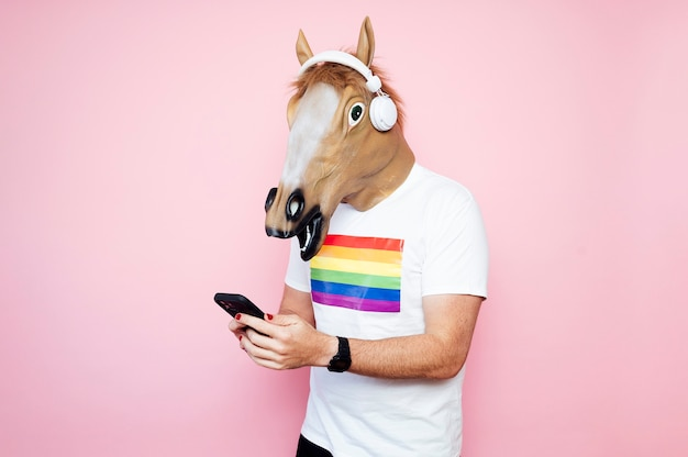 Man in a horse mask playing electric guitar.