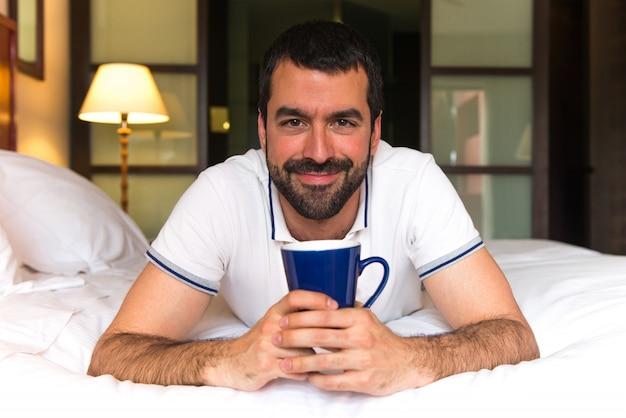 Man in a hotel drinking coffee