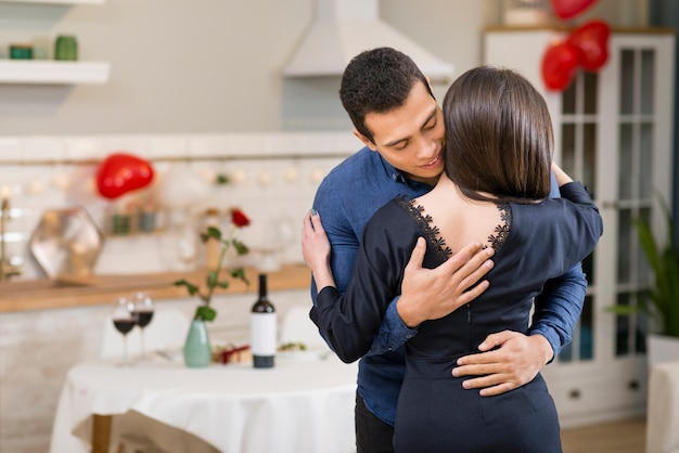 Man hugging his wife with copy space
