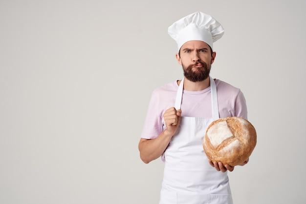 シェフの服を着た男パン屋小麦粉製品調理作業。高品質の写真