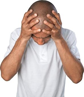 白で隔離の手で頭を保持している感情的なストレスの男