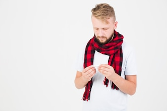 Man in red scarf with thermometer