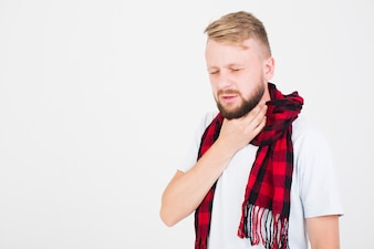 Man in scarf having sore throat