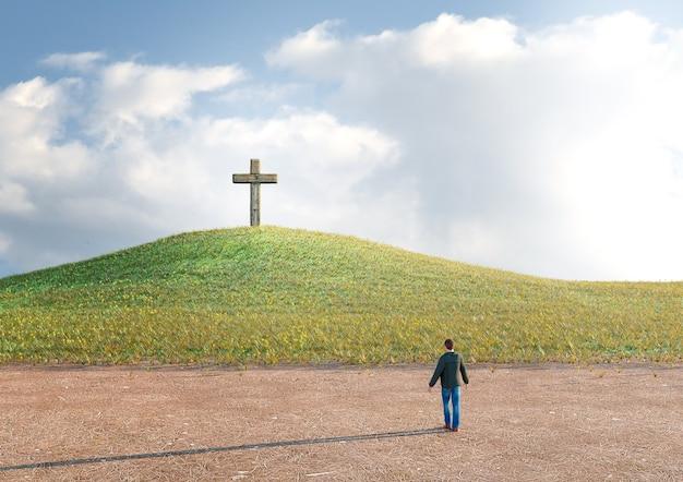 십자가를 바라 보는 예수 그리스도를 믿는 믿음으로 구원을 구하는 사막에있는 남자.