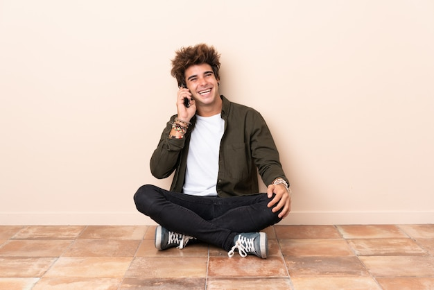 Man at indoors sitting on the floor