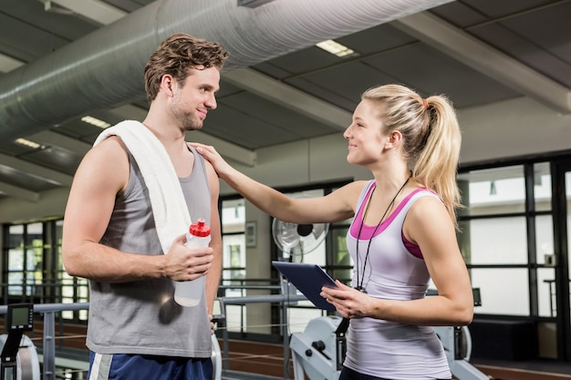 Man interacting with his trainer after a workout