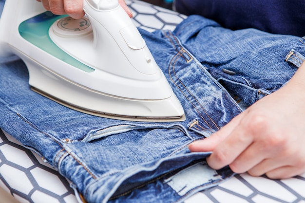 Man ironing jeans