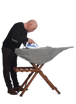 Man ironing on white background