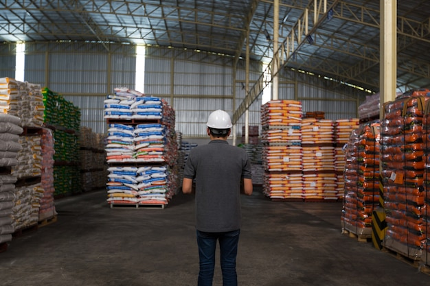 A man is checking the product quality in the warehouse. warehousing, quality control