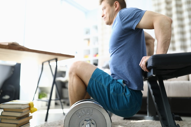 Man is doing physical exercises at home closeup