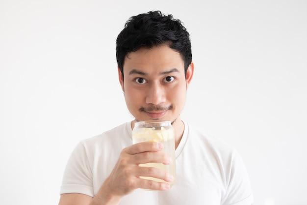 Man is drinking iced lemon soda on isolate white background