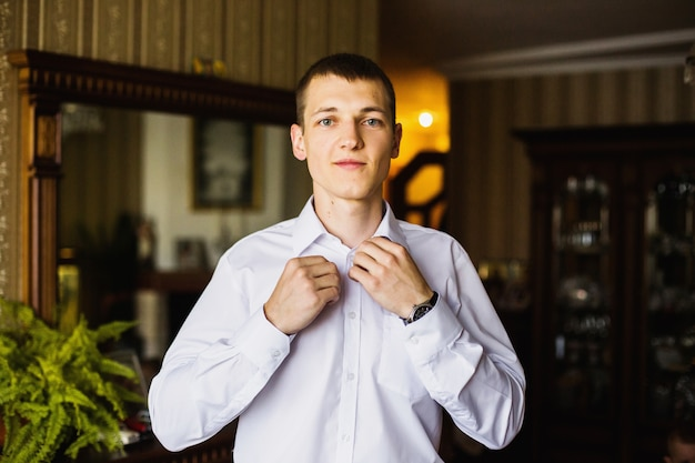 The man is going to work. charges groom. business portrait in an interior