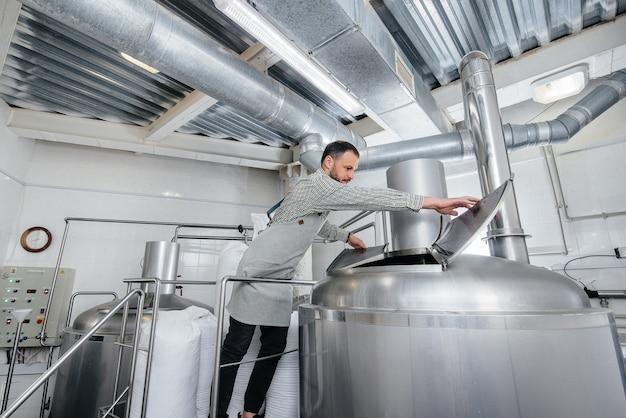 A man is preparing beer in a brewery.