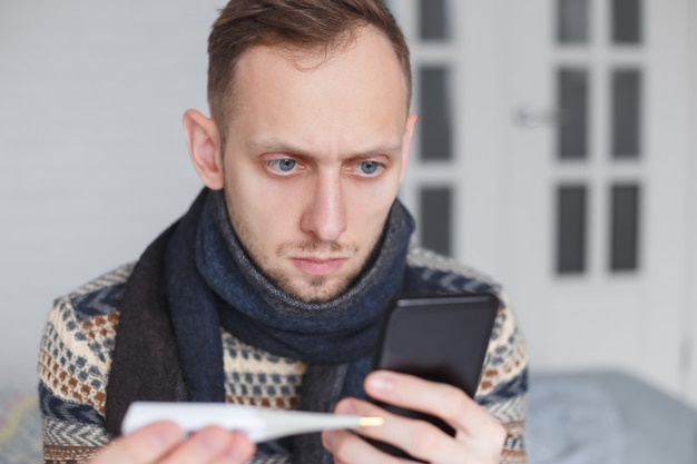 Man is self-medicating looking for treatment on the internet instead of visiting a doctor.