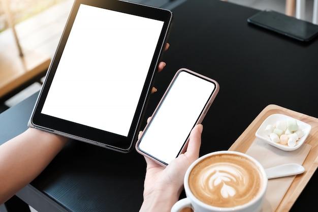 A man is showing digital tablet blank screen in coffee shop.