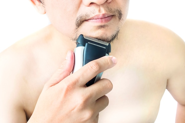 Man is using shaver isolated over white background
