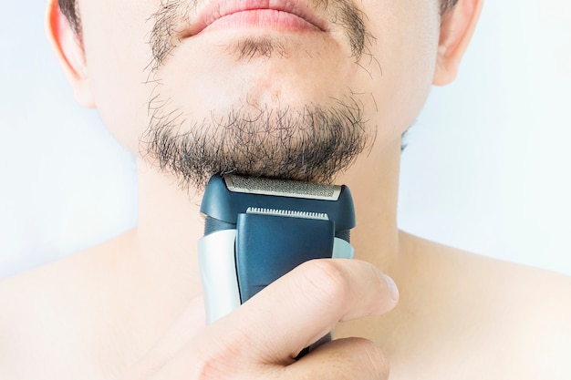Man is using shaver