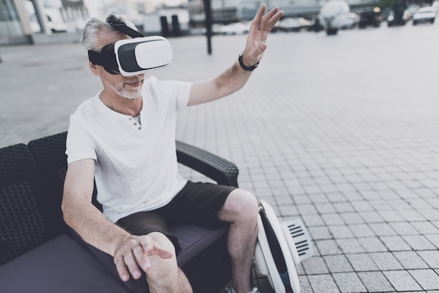 Man is using a virtual reality glasses