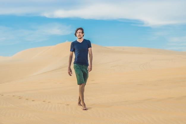 A man is walking in the desert vietnam, mui ne