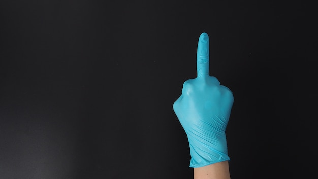 Man is wearing blue latex gloves and do the middle finger hand sign.use it when you want to say