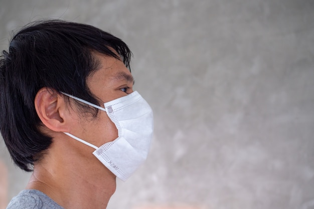 A man is wearing a mask to prevent the covid-19 virus