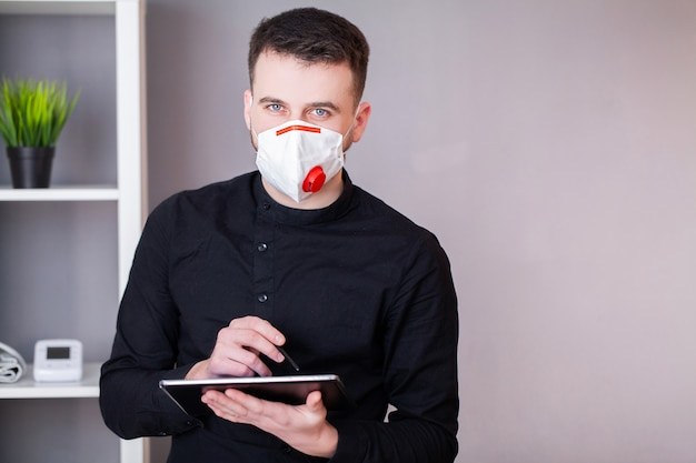 Man is wearing a mask for protection from coronavirus