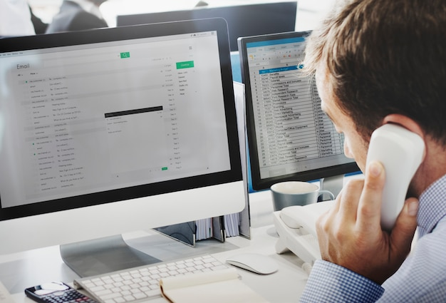 A man is writing an e-mail