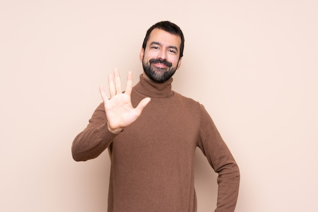 Man over isolated  counting five with fingers