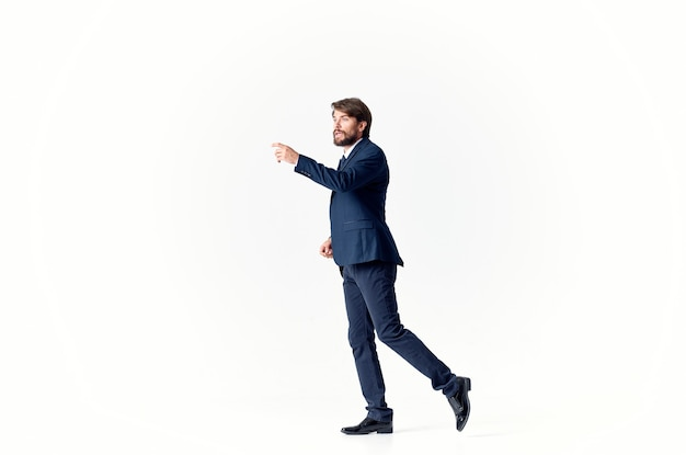 Man in a jacket and tie emotions successful light background