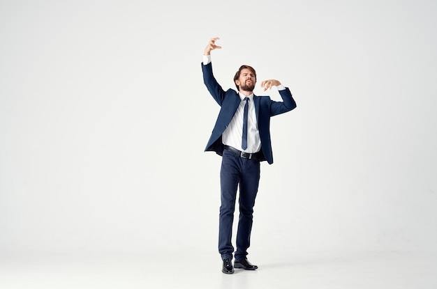 Man in a jacket and tie posing executive light background