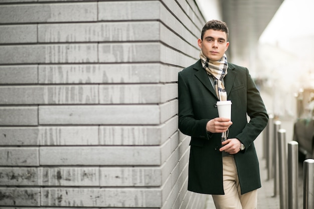 Man in jacket with coffee