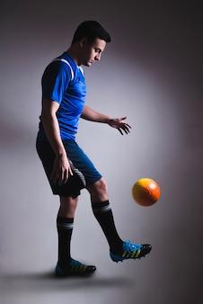 Man juggling football