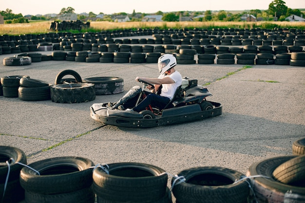 Man in a karting circuit with a car