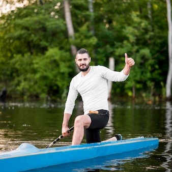 Man in kayak showing approval